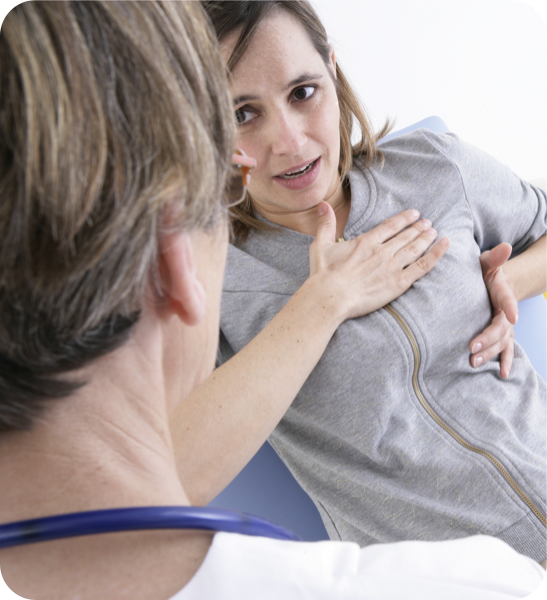 Patient with breast pain explaining to physician